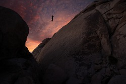 Highline walker over granite domes with nice sunset, Joshua Tree National Park