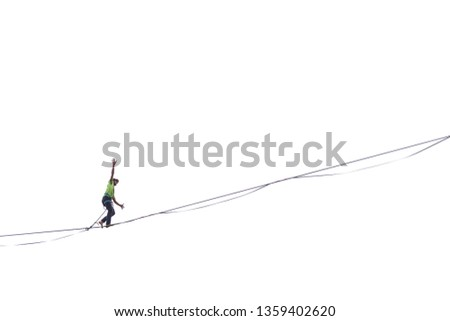 Highliner on a white background. Highline against the sky. A man catches the balance on a stretched sling. Barefoot tightrope walker follows the line. Equilibrium. Overcoming the fear of heights.
