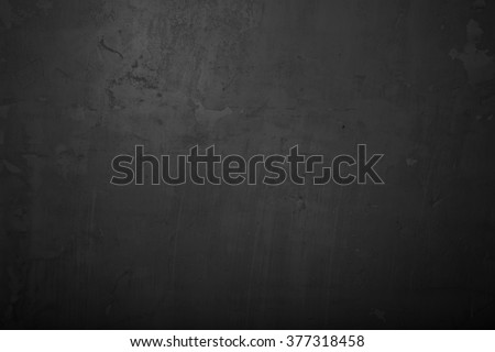 Highly detailed and empty black concrete wall. Dark background, horizontal
