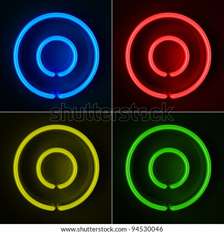 Highly detailed neon sign with the letter O in four colors