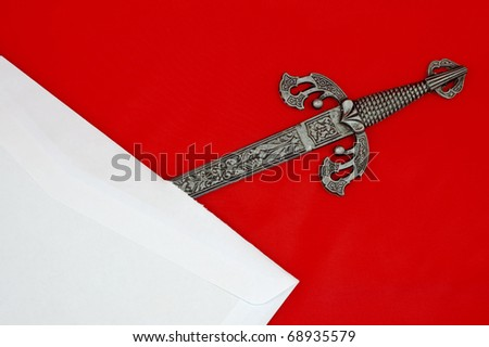 Highly detailed sword shaped letter opener opening a white envelope isolated on red