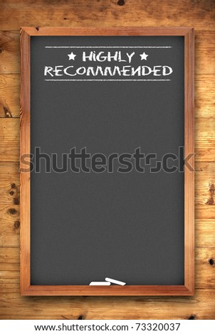 highly recommended chalkboard on wooden background