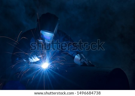 Highly skilled welder workers are welding in the construction site in the factory. Photo stock ©
