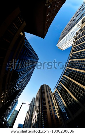 Highrise skyscraper buildings in a big city with blue sky urban setting Chicago #1330230806