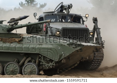 HIGHT SPEED TRACK DOZER AND INFANTRY FIGHTING VEHICLE -  Military tracked vehicles on the wilderness #1559591711