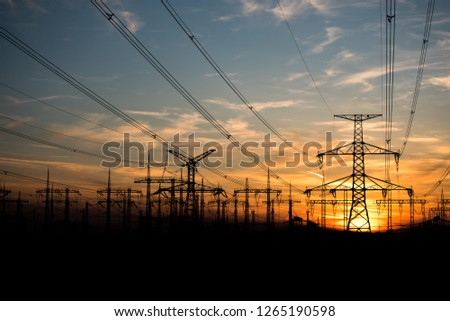 Hight voltage electric towers during sunset.