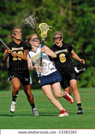HIGHTSTOWN, NJ - MAY 13: Members of the #2 Nationally ranked Moorestown High School girl's lacrosse team battle with competitors from the Peddie School in a game on May 13, 2010 in Hightstown, NJ