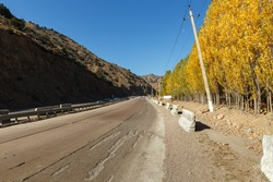 highway A 373, Tashkent Osh highway, Kamchik pass, Uzbekistan. mountain road in autumn.