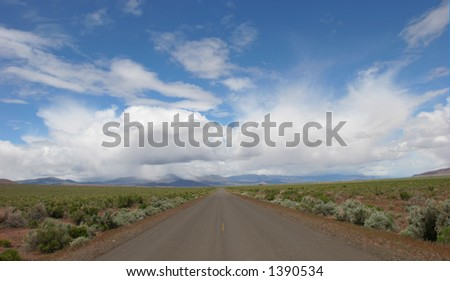 Highway and Cloudy Skies