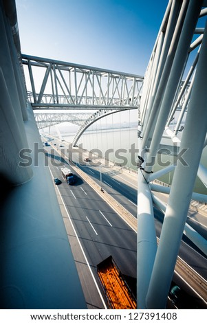 highway and modern bridge of city,blue toned. - stock photo