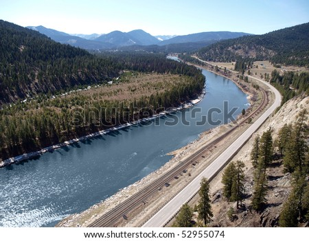 Highway and railroad tracks run along side the Clark Fork near Paradise Montana.