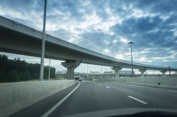 Highway and viaduct under the blue clouds.