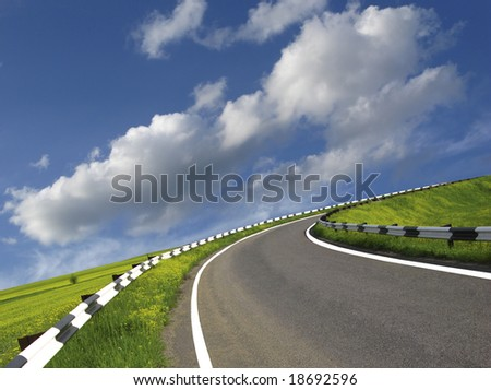 highway and white clouds in  dark blue sky