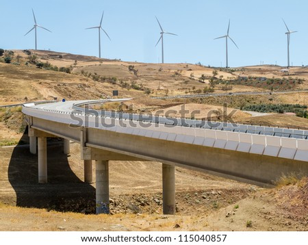 highway and wind turbines - stock photo