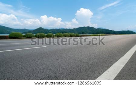 Highway Asphalt Pavement and Natural Landscape #1286561095