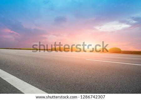 Highway Asphalt Pavement and Natural Landscape #1286742307