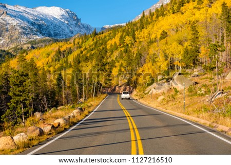 Highway at autumn sunny day in Rocky Mountain National Park. Colorado, USA.  #1127216510