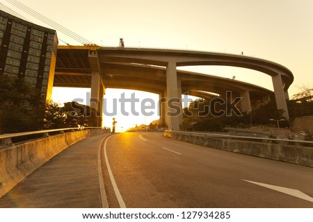 Highway at sunset - stock photo