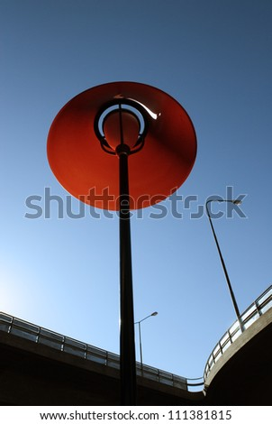 Highway bridge and a red lamp, Stockholm, Sweden