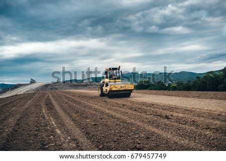 Highway construction site details - working tandem vibration machinery