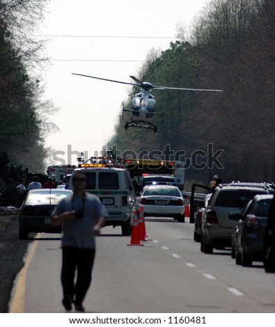 Highway crash wreck with helicopter and rescue workers