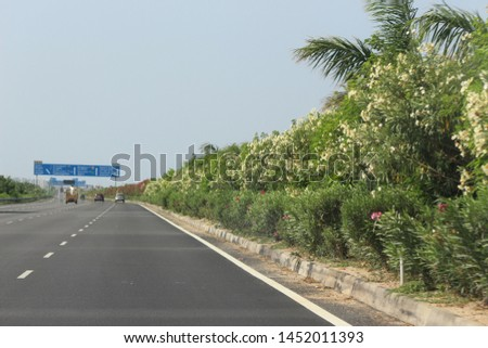 Highway divider plants on outer ring road Highway road Hyderabad  #1452011393