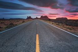 Highway 163 going through Monument Valley at sunset