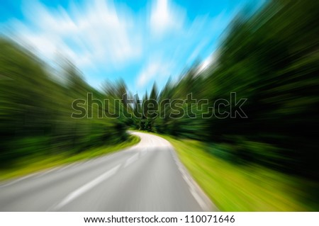 Highway in forest in motion blur