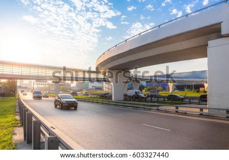 Highway interchange with bridge on the background #603327440