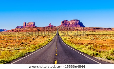 Highway 163 leading to the towering sandstone Buttes and Mesas of the Monument Valley Navajo Tribal Park in Utah-Arizona, United States. 'Forest Gump Point' where he stopped his cross country run
