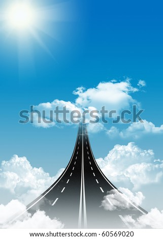 Highway leading up to clouds in the sky