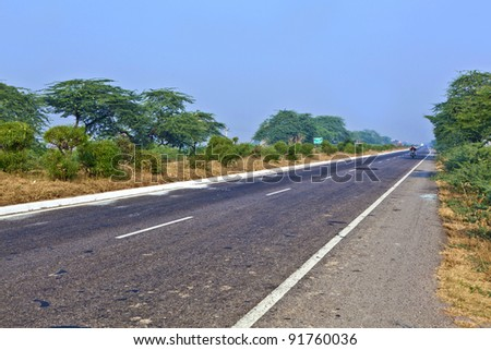 Highway near Agra, India. NH2, a modern divided highway, connects the 200 km distance from Delhi to Agra.
