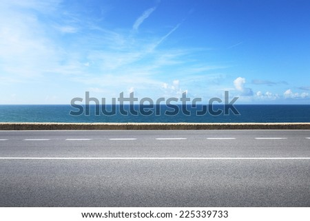 Highway on sunny summer day near the water #225339733