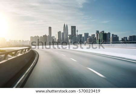 Highway overpass motion blur with city background . sunset scene .