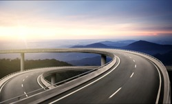 Highway overpass motion blur with nature mountain background during sunrise