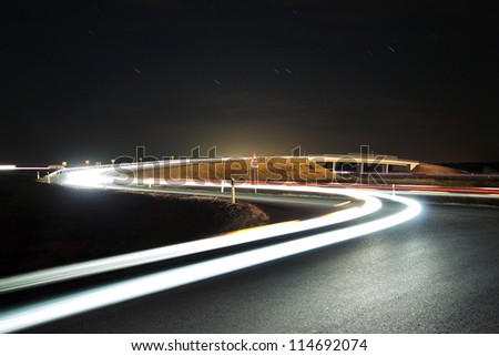Highway overpass with car lights