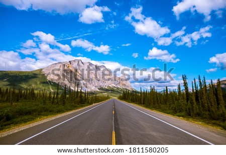 Highway road in mountain valley. Road in mountains. Mountain road landscape. Road to mountains
