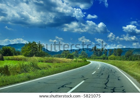 Highway Road in Rural Beautiful Landscape - amazing summer cloudscape in the beautiful blue sky