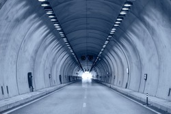 Highway road tunnel with car light