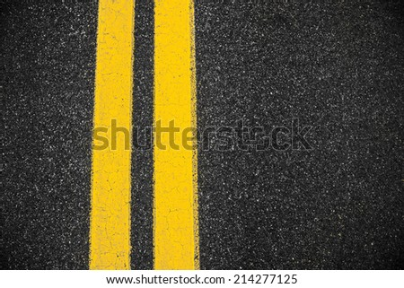 Highway surface with two yellow lines. Asphalt background #214277125