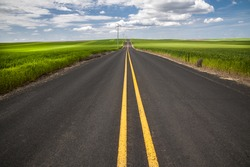 Highway through wheat fields in Washington State