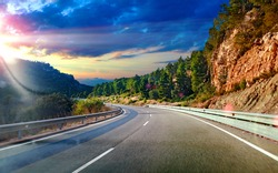 Highway to destiny.Tranquility and safety driving.Road and travel concept.Sunset landscape and mountains