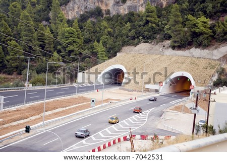 highway traffic by tunnels - stock photo