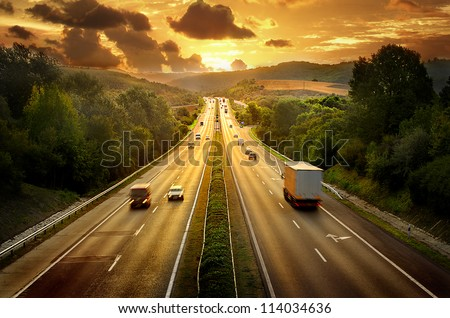 Highway traffic in sunset #114034636