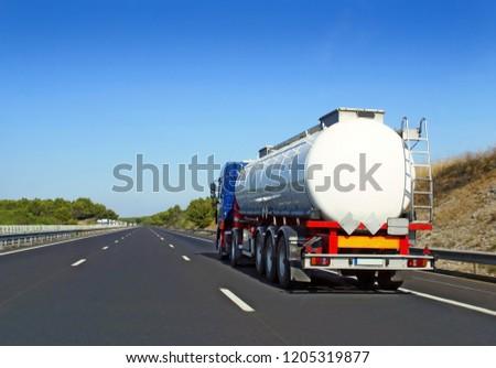 Highway transport by tanker truck.               #1205319877