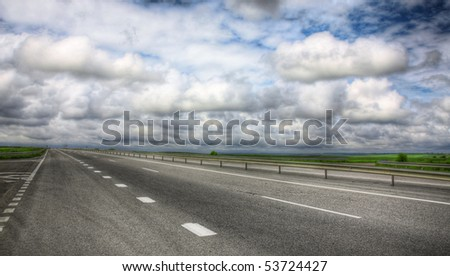 Highway under the cloudy sky