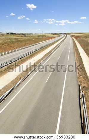 highway with blue and cloudy sky