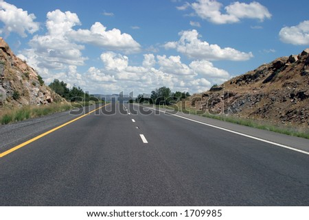 Highway with blue sky and vanishing point