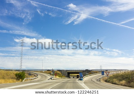 highway with blue sky and white clouds background - stock photo