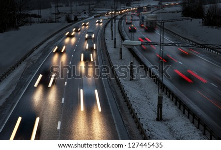 Highway with busy traffic on winter evening